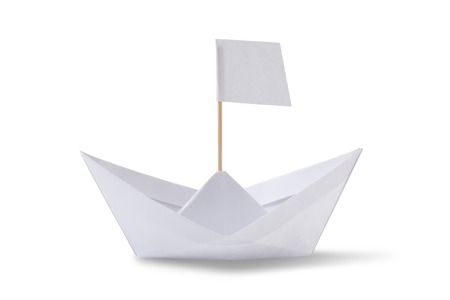 Origami paper ship with white flag