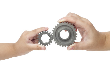 toothed: Hands holding gear Stock Photo