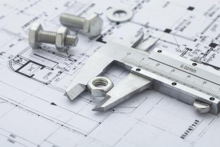 calipers:  Vernier calipers measuring metal nut Stock Photo