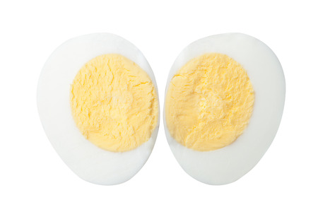two halves of a boiled egg isolated on white background 写真素材