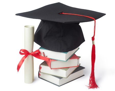Graduation cap and diploma with books isolated on white photo