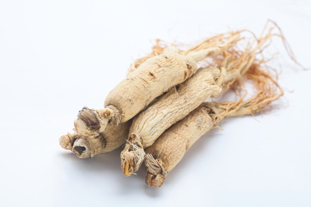 dry ginseng roots on white background