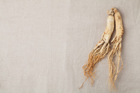 dry ginseng roots on the burlap Imagens - 34481632