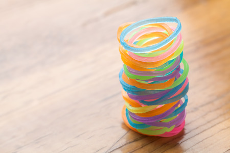 rubberband: Colored rubber bands on wooden table