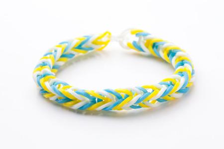 accessorize: Loom rubber bracelets on white background