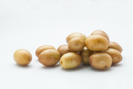 rutaceae: Fresh wampee fruit on white background, South Chinas tropical fruit.