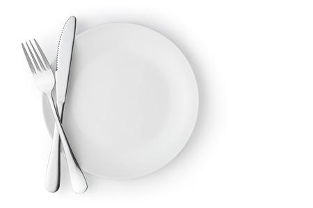 空の皿の上にナイフとフォーク白で隔離。 写真素材