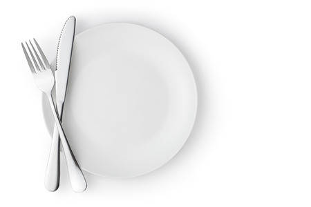 silver cutlery: Fork and knife on a empty plate, Isolated on white.