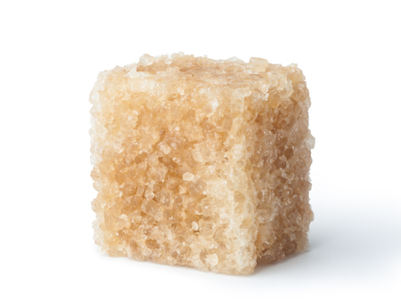 sugar cube: Brown cane sugar cube isolated on white background