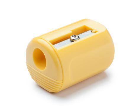 office tool: Yellow pencil sharpener on white background