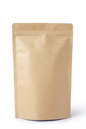 product packaging: Brown paper food bag packaging with valve and seal, Isolated on white. Stock Photo
