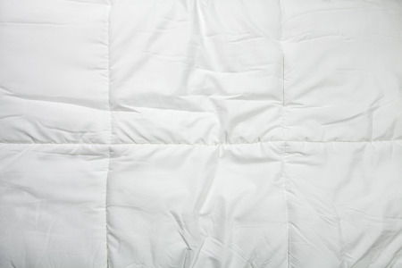 comforter: White quilt texture background, Close-up. Stock Photo