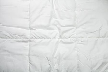 duvet: White quilt texture background, Close-up. Stock Photo