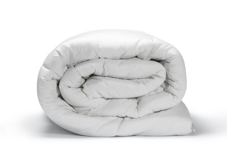 confortable: Warm and confortable folded white quilt on white background