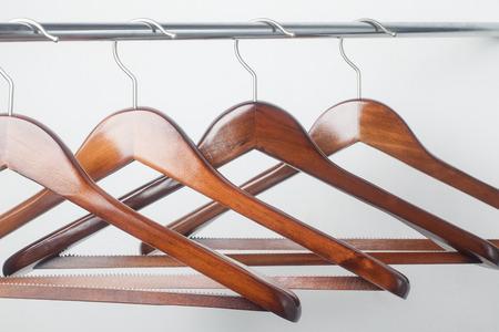 coat hangers: Empty wooden coat hanger, Close-up.