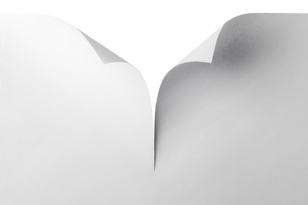 curled corner: Empty white paper with curled corner, Close-up. Stock Photo