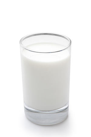 Glass of milk on white background Фото со стока