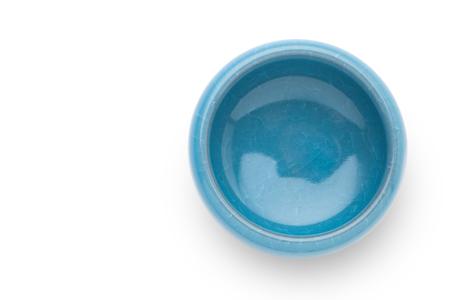 ceramiki: Chiński ceramiki kubek herbaty na białym tle, widok z góry.