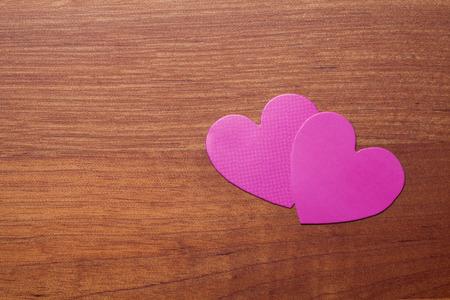paper board: Heart shaped paper on a wooden board