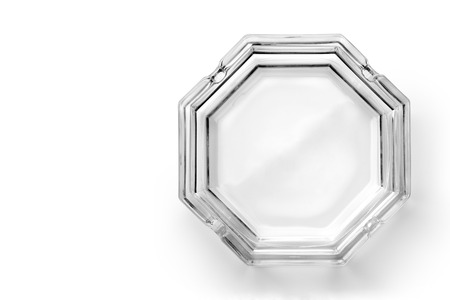 Octagonal glass ashtray isolated on white background. Top view. Stock Photo