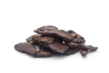 Sliced of Rehmannia Glutinosa Root, Isolated on white background. Chinese herbal medicine.