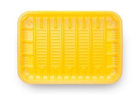 Yellow empty food tray isolated on white background. Top view. Imagens