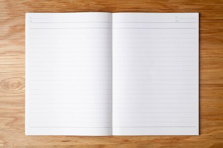 Blank notebook on wooden table. Top view.