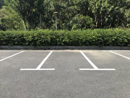Empty outdoor parking space. Car parking lot with white lines mark.