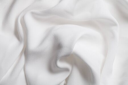 Smooth white silk fabric texture. Abstract background 스톡 콘텐츠
