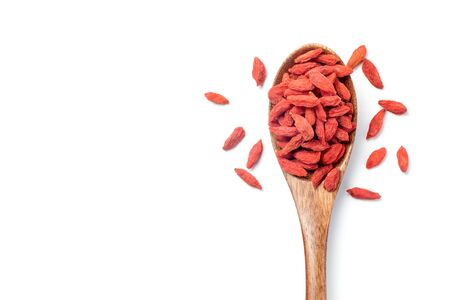 Dried goji berries (Chinese wolfberry) in a wooden spoon, Isolated on white background. Top view. 스톡 콘텐츠