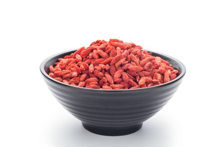 Dried goji berries (Chinese wolfberry) in a black bowl, Isolated on white background.