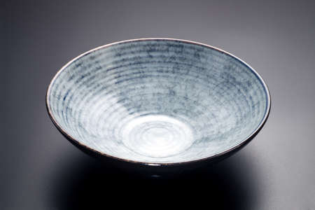 empty ceramic bowl on black background 스톡 콘텐츠