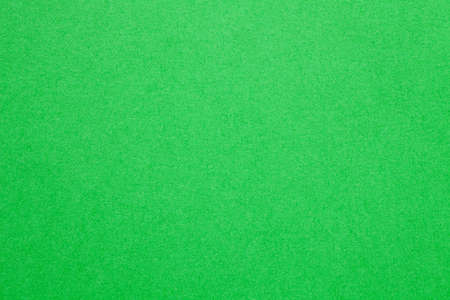 Sheet of green paper texture background