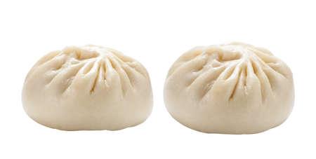 Fresh baozi (Chinese steamed buns) isolated on white background. 版權商用圖片