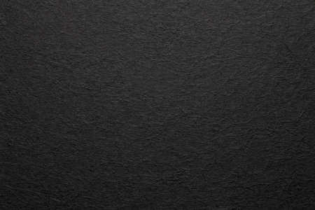 Sheet of black paper texture background