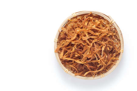 Shredded dried bamboo shoots in a basket isolated on white background. Top view.