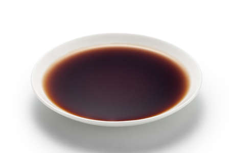 Dish of mature vinegar isolated on white background. Chinese traditional condiments.