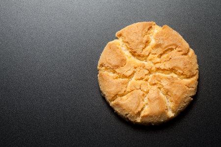 Walnut cake or crisp biscuit on black background. Top view. 版權商用圖片