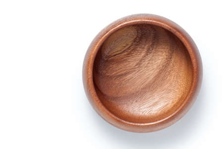 Empty wooden bowl isolated on white background. Top view.