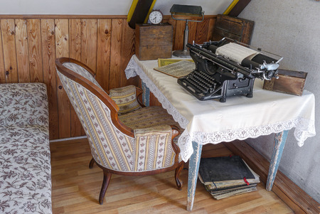 Retro office with old typewriter and vintage chair.