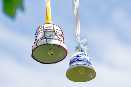 jingle: Jingle bells with ornaments climbing on blue sky and ringing