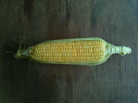 flay: Peel corn on table