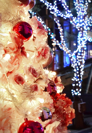 Close-up decorated christmas tree with flower and ball and illuminations lights on background in Tokyo, Japan