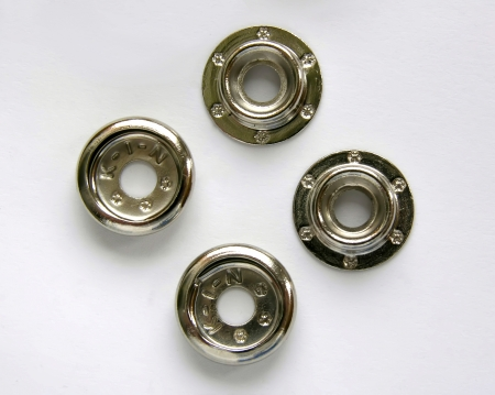 rustproof: Set of snap fasteners, brass, isolated on white