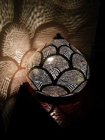 Small oriental lamp with shadow and light on the wall photo