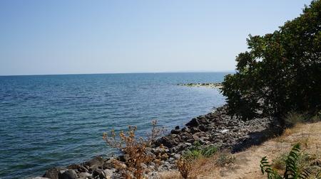 skie: Beach at Nessebar wiht rocks, Bulgaria Stock Photo