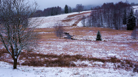 Meadow in winter with river Stock Photo