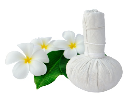herbal cosmetics: Thai herbal compress for spa with white plumeria flower   frangipani   isolated on white Stock Photo