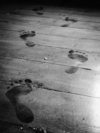 dusty: close up step forward on dusty floor monochrome Stock Photo