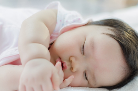 asian baby: close up of asian baby girl sleeping Stock Photo